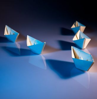white paper boats on white surface